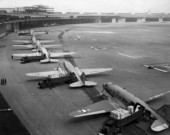 U.S. Navy Douglas R4D and U.S. Air Force C-47 Skytrains unload at Tempelhof Airport during the Berlin Airlift in 1948