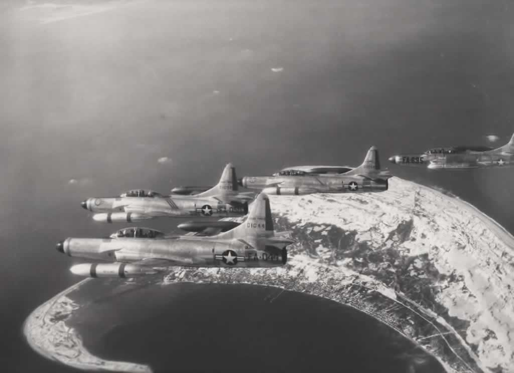 U.S. Air Force F-94C Starfires flying in information ... S/N 50-1044, Buzz Number FA-044 is in the foreground