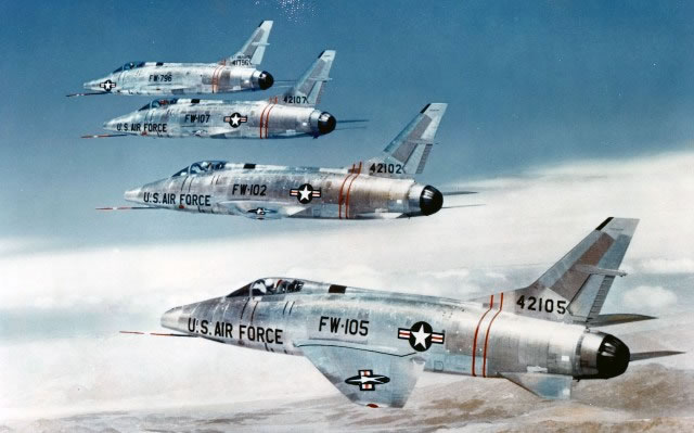 Flight formation of four F-100 Super Sabre jet fighters