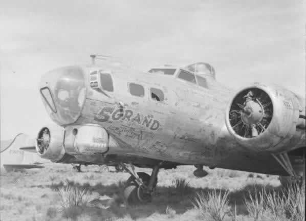 "B-17G ""Five Grand"" S/N 43-37716 awaiting the scrapping process at Kingman AAF in Arizona This was the 5,000th B-17 built by Boeing in support of the World War II effort. It contained the signature of Boeing workers written all over the aircraft. In wartime action, it flew 78 missions with the 96th Bomb Group."
