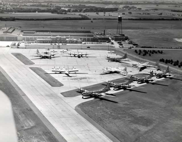 Boeing Wichita Plant, aerial view of completed B-29s parked on apron with part of the original Stearman Aircraft plant in the background
